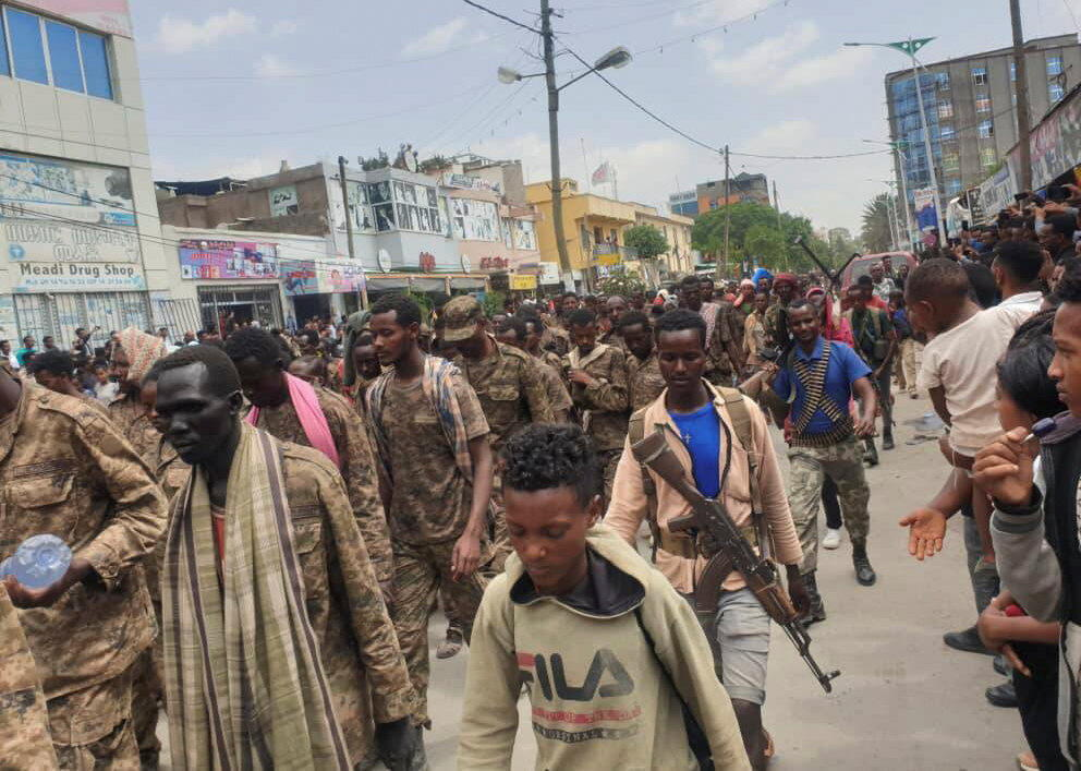 Ethiopian government soldiers and prisoners of war in military uniforms walk the streets of Mekelle, the capital of Ethiopia's Tigray region, July 2, 2021.