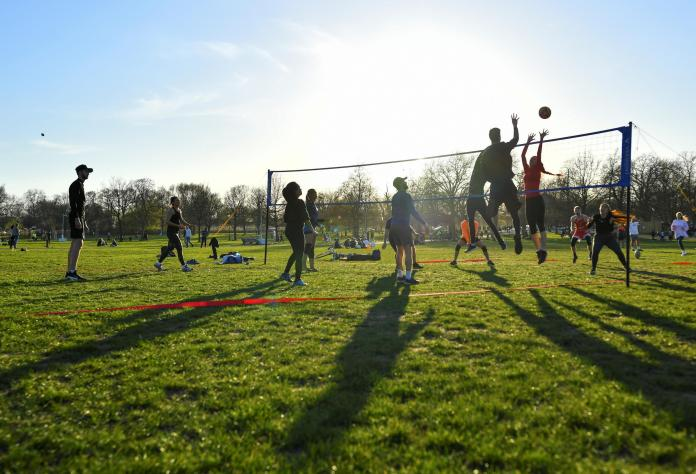 A game of volleyball allowed at Clapham Common, London on March 29, 2021.