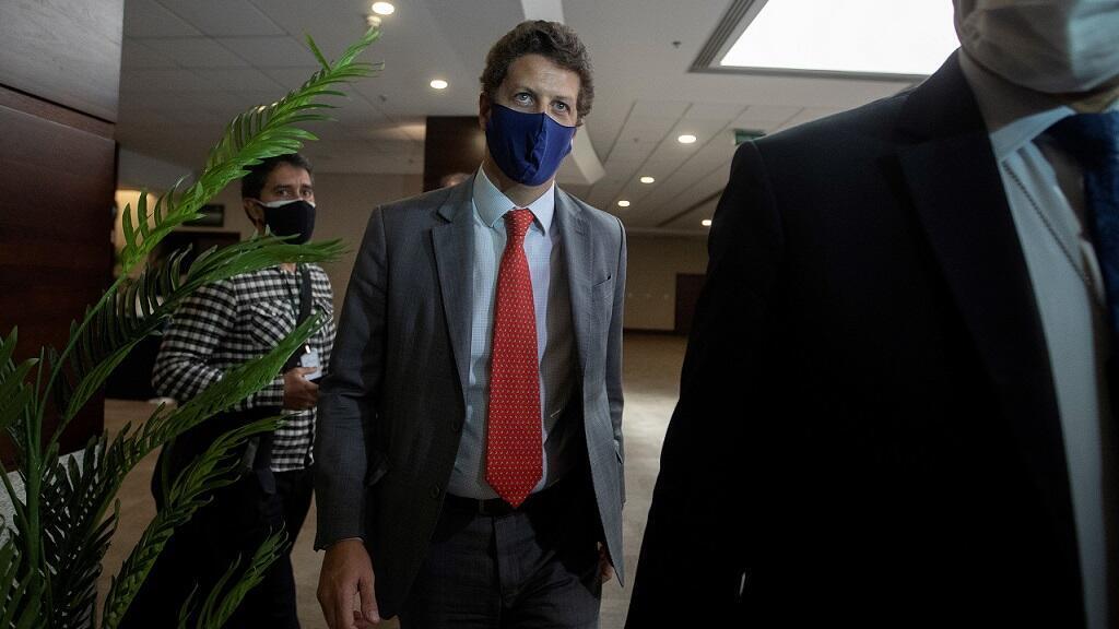 Brazil's Environment Minister Ricardo Salles walks after leaving an event in Brasilia, Brazil, on May 19, 2021.