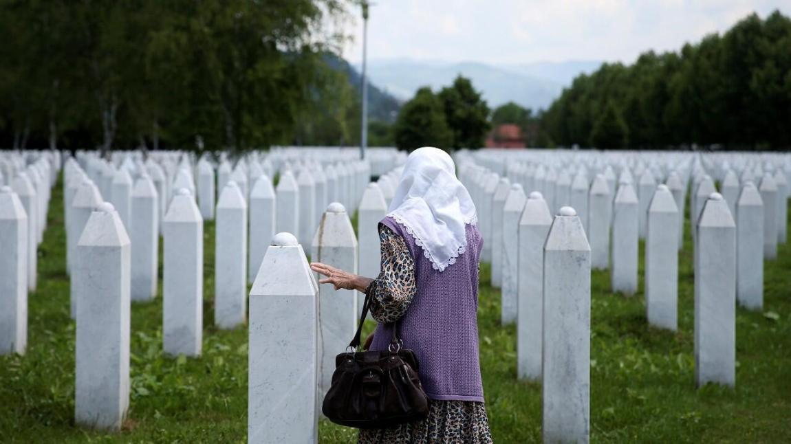 A Bosnian Muslim woman visits the memorial for the victims of the Srebrenica genocide in Potocari, Bosnia and Herzegovina, on June 8, 2021.