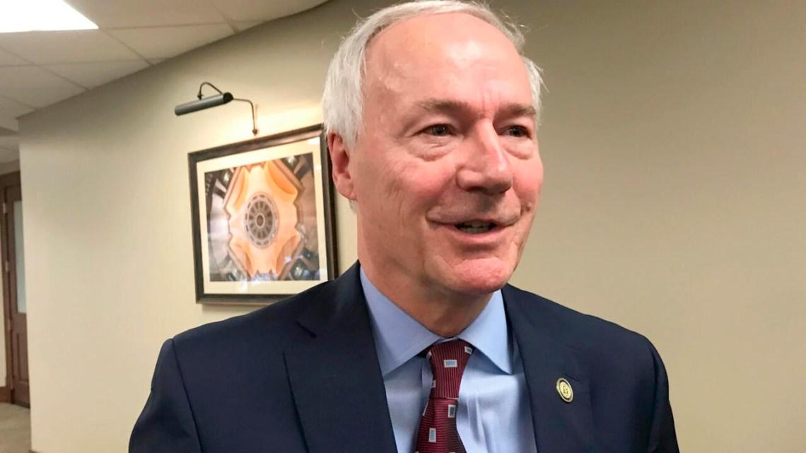 In this Jan. 13, 2020, file photo, Arkansas Gov. Asa Hutchinson speaks to reporters in Little Rock, Arkansas.