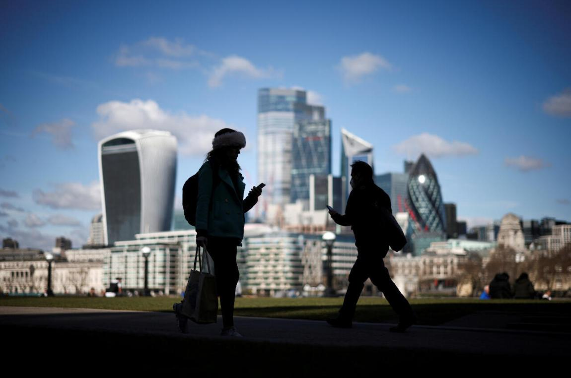 File: The City of London financial district can be seen as people walk along the south side of the River Thames amid the outbreak of the coronavirus disease (Covid-19) in London on March 19, 2021.
