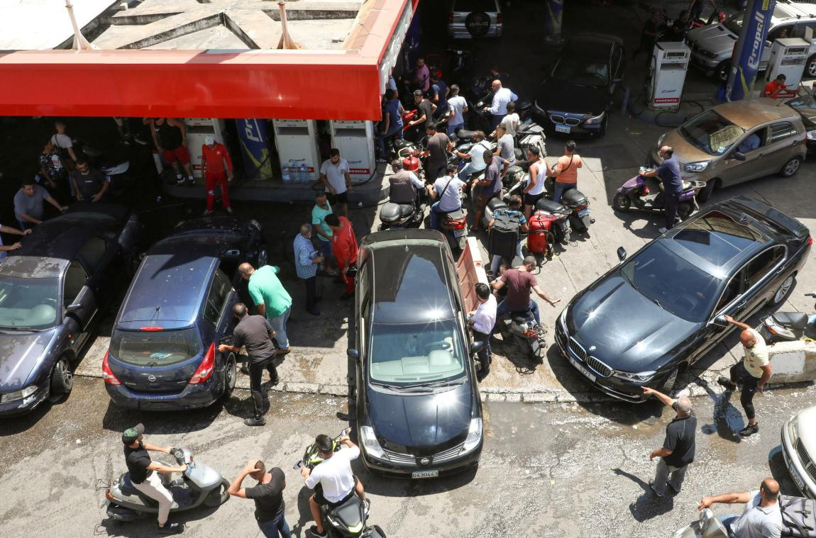 Motorcycle and car drivers wait at a gas station to refuel in Beirut, Lebanon, on June 29, 2021.