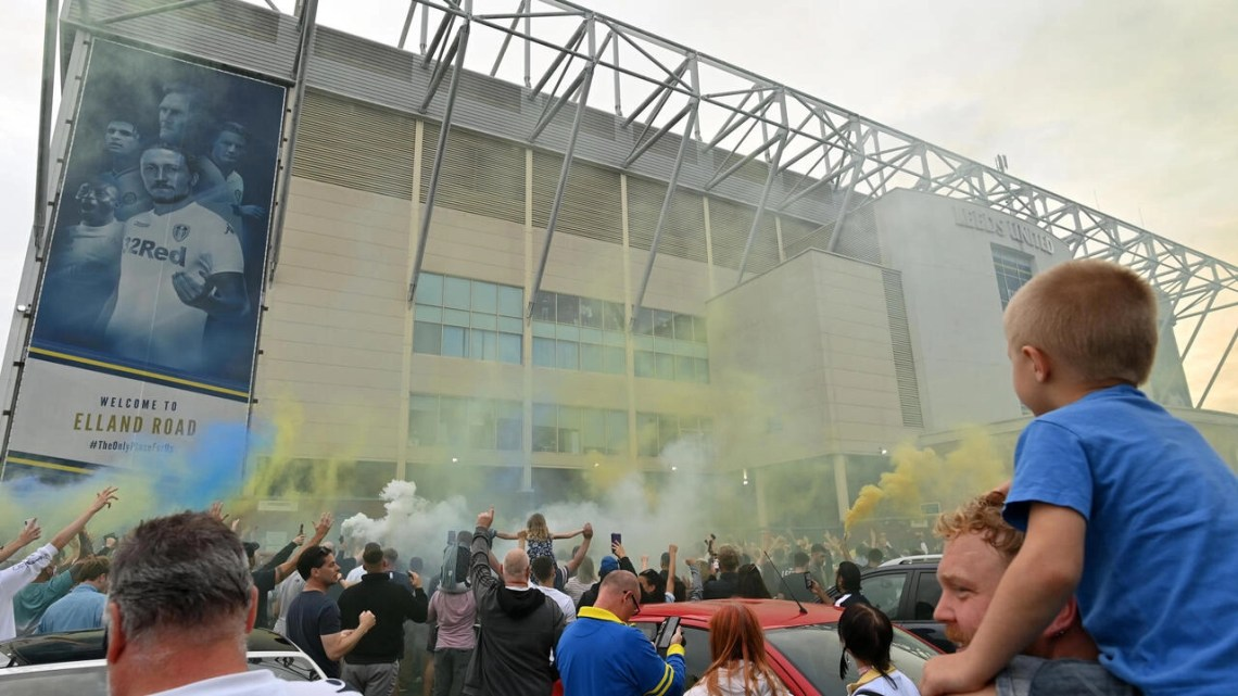 Leeds United supporters celebrated their team's promotion to the Premier League after a 16-year absence on Friday