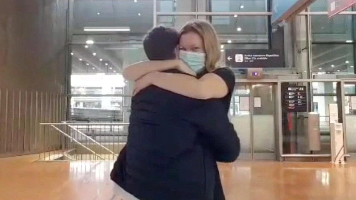 Binational couple Lauren Child (American) and Xavier Sobanski (French) are reunited at Paris's CDG airport on September 27 2020 after spending 264 days apart.