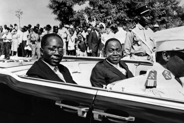 Ivory president Felix Houphouet Boigny (R) and Senegalese President Leopold Sedar Senghor parade in the official car, on August 10, 1961 in Abidjan, during the first Independence day anniversary.