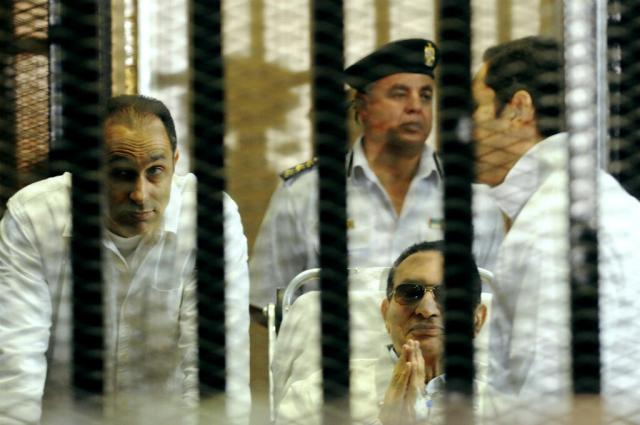 Hosni Mubarak, centre, with his sons Gamal, left, and Alaa, right at a court hearing April 13, 2013.