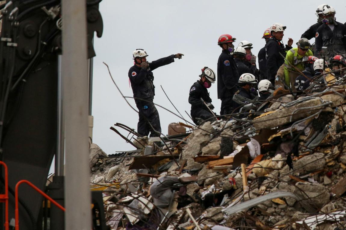 Rescue personnel continue the search and rescue operation for survivors at the site of a partially collapsed residential building in Surfside, near Miami Beach, Florida, USA on June 30, 2021.