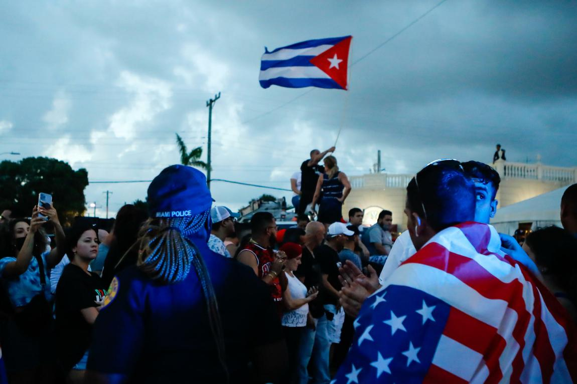 Cuban-Americans demonstrate in Little Havana, a Miami neighborhood, waving Cuban and American flags, in a march in support of anti-government protests in Cuba on July 11, 2021