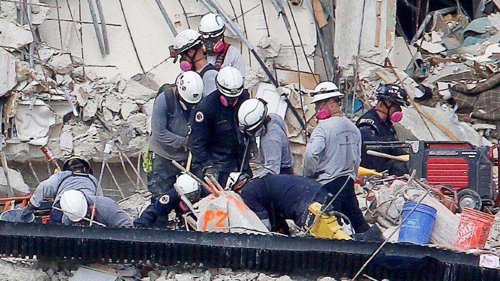 Emergency workers conduct search and rescue efforts at the site of a partially collapsed residential building in Surfside, near Miami Beach, Florida, USA, June 30, 2021.