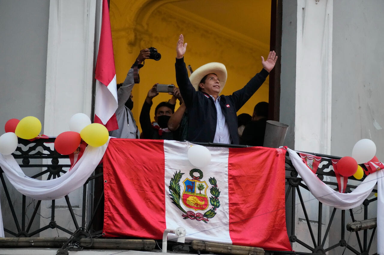 File photo of Pedro Castillo greeting supporters celebrating the partial election results that showed him leading Keiko Fujimori, at his campaign headquarters in Lima, Peru, on Monday, June 7, 2021.