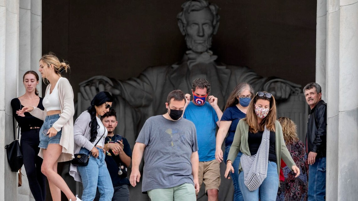 Some tourists wear masks at the Lincoln Memorial in Washington, DC, where not everyone is ready to give up face coverings just yet