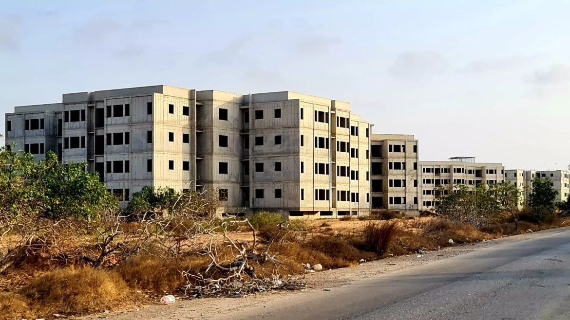 Apartment blocks lie unfinished in the Libyan coastal town of Tajura, another victim of the decade-long halt to infrastucture spending that now makes the country a magnet for foreign contractors