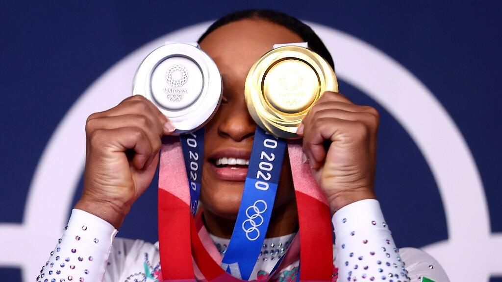 Brazilian gymnast Rebeca Andrade poses with her gold and silver medals achieved at the Olympic Games in Tokyo, Japan, on August 2, 2021.