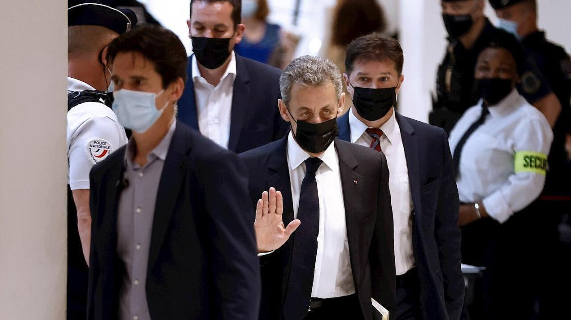 Former French President Nicolas Sarkozy (center) arrives at the Paris courthouse for trial for alleged illegal financing of his failed 2012 re-election campaign, at the courthouse in Paris, France, on June 15, 2021.