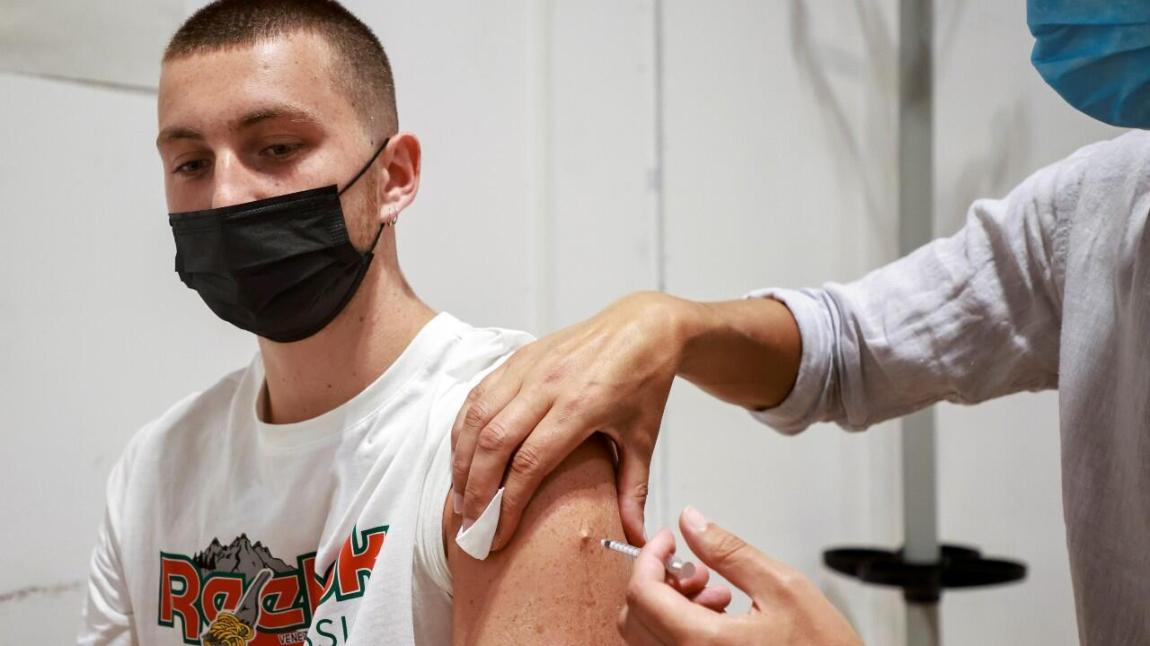 A medical worker administers a dose of the Pfizer-BioNTech vaccine against coronavirus disease (COVID-19) at a vaccination center in Paris, France, on July 23, 2021.