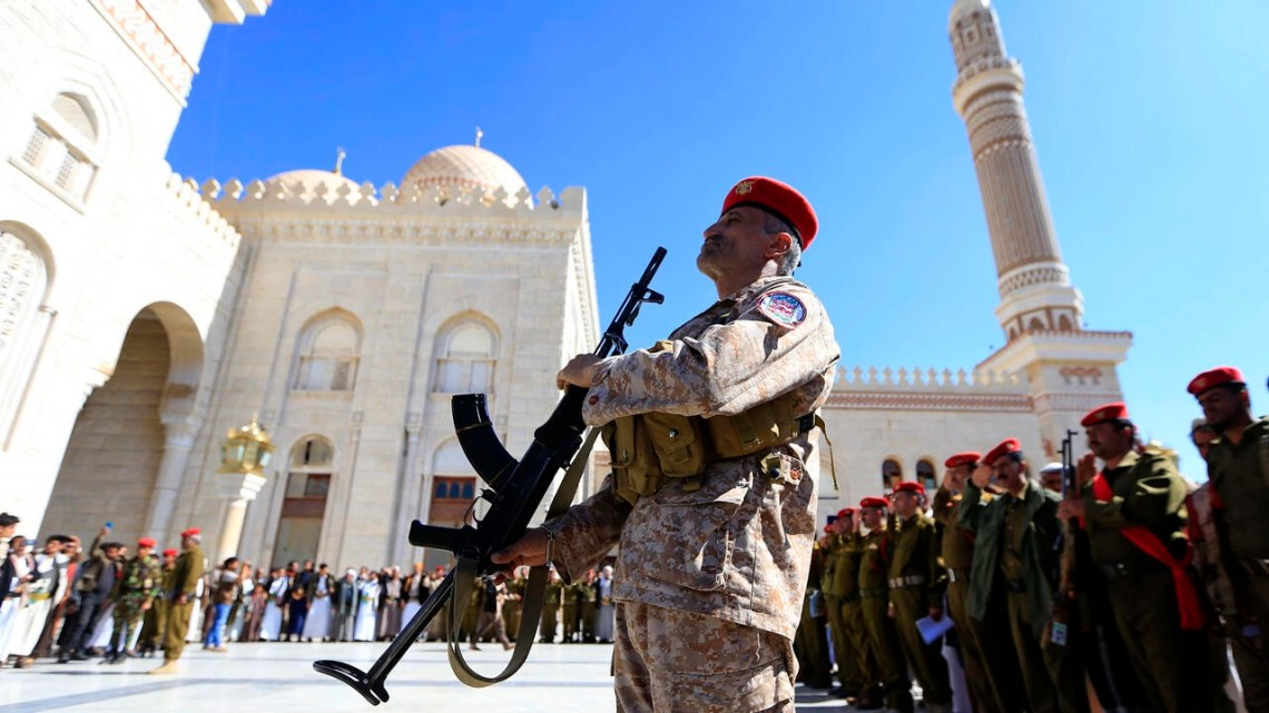 Soldiers attend the funeral in Yemen's capital Sanaa of pro-Huthi fighters killed in battle in November 2020 as the United States steps up pressure on the Iranian-backed insurgents
