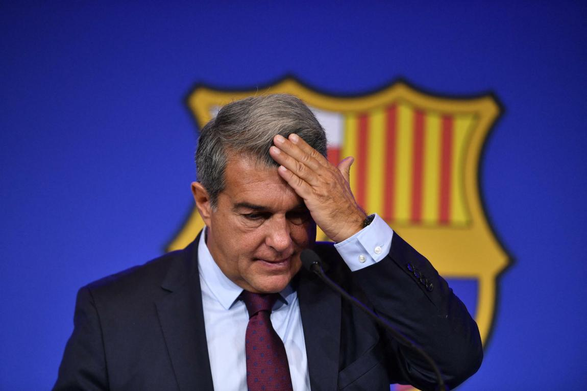 """The president of FC Barcelona Joan Laporta offers a press conference at the Camp Nou stadium in Barcelona on August 6, 2021 to explain the departure of Lionel Messi.  Soccer star Lionel Messi will leave FC Barcelona after talks for a new contract fail due to """"financial and structural obstacles""""."""