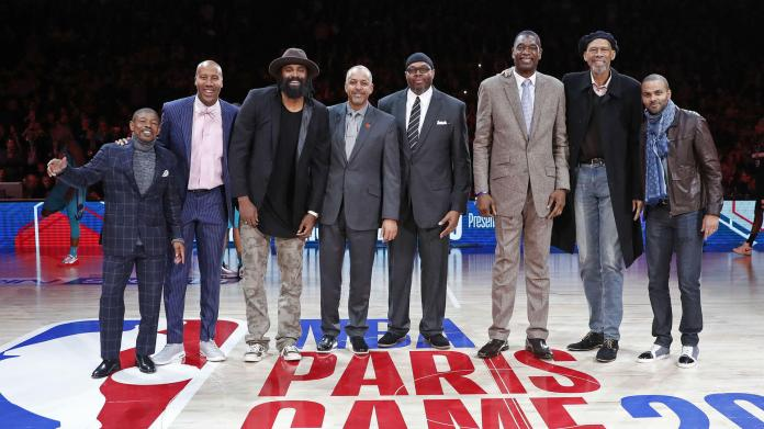 Left to right: Muggsy Bogues, Bruce Bowen, Ronny Turiaf, Dell Curry, Sam Perkins, Dikembe Mutombo, Kareem Abdul-Jabbar and Tony Parker.