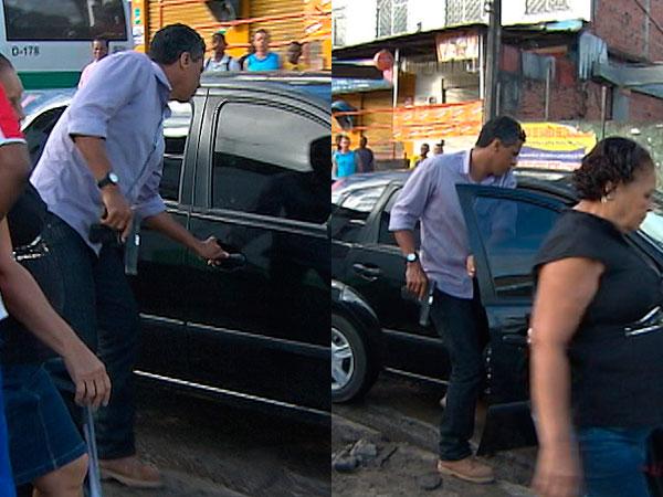 Homem mostra arma em manifestação no bairro de Águas Claras (Foto: Reprodução/TV Bahia)