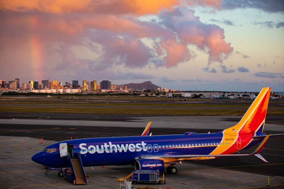 Southwest Airlines Boeing 737-800 at Daniel K. Inouye International Airport - with Diamond Head and rainbow in the backgroud Photo: SWA