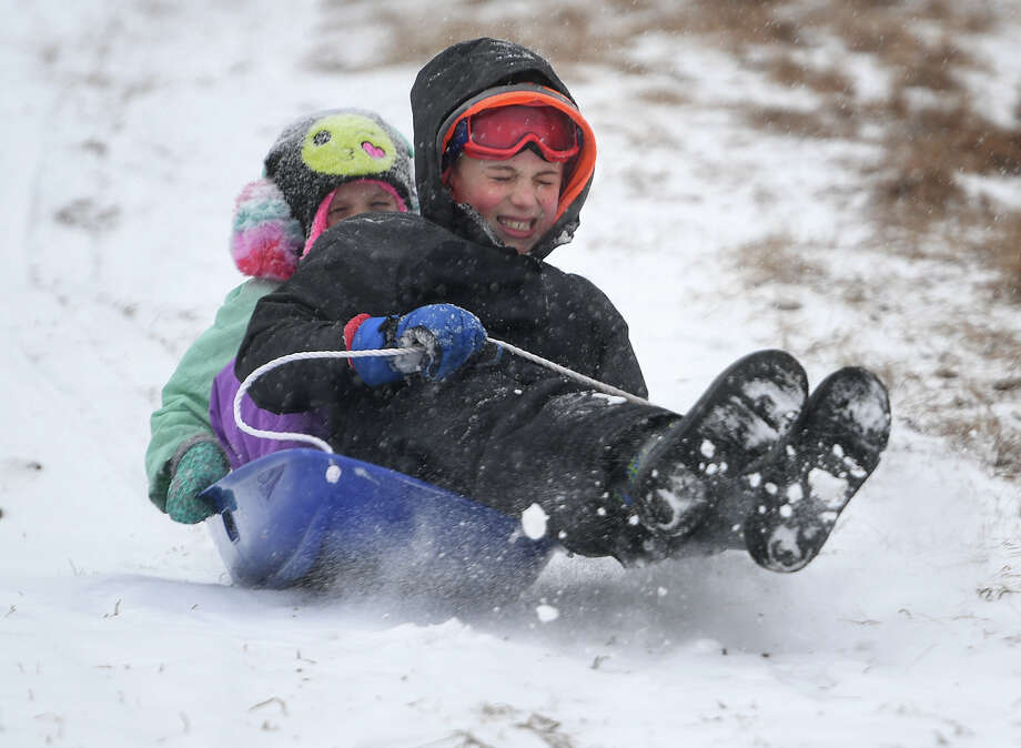 Siblings Anne, 6, and Ethan Arnett, 8, of Fairfield, enjoy a snow day off from school with a morning of sledding at Sturges Park in Fairfield, Conn. on Tuesday, February 12, 2019. Photo: Brian A. Pounds, Hearst Connecticut Media / Connecticut Post