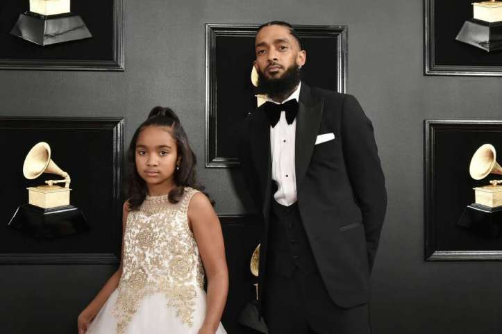 FILE – Emani Asghedom and Nipsey Hussle attend the 61st Annual Grammy Awards at Staples Center in this February 10, 2019 file photo in Los Angeles. According to the Los Angeles Police Department, Hussle was shot in front of his Los Angeles store on Sunday, March 31, and has died at age 33, according to multiple reports. Photo: David Crotty/Patrick McMullan Via Getty Image