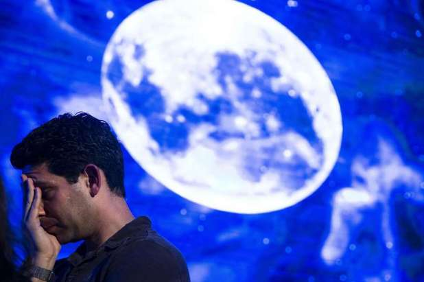 TEL AVIV, ISRAEL - APRIL 11: An Israeli man reacts after the Beresheet spacecraft does not land safely on the moon on April 11, 2019 in Tel Aviv, Israel. The Israeli spacecraft, called Beresheet, which is a joint project between SpaceIL, an Israeli nonprofit organization with private funding, and Israel Aerospace Industries did not land on the lunar surface after the apparent failure of its main engine. (Photo by Amir Levy / Getty Images) Photo: Amir Levy, Getty Images