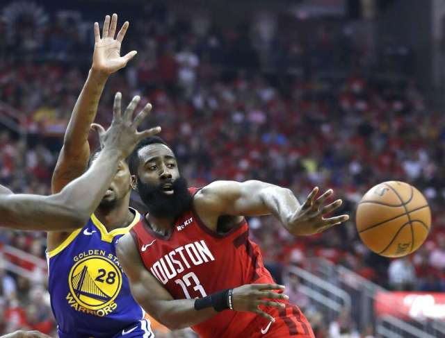 Houston Rockets guard James Harden (13) passes the ball out of the lane against the Golden State Warriors during the first half of Game 6 of the NBA Western Conference semifinals at Toyota Center on Friday, May 10, 2019, in Houston. Photo: Karen Warren, Staff Photographer
