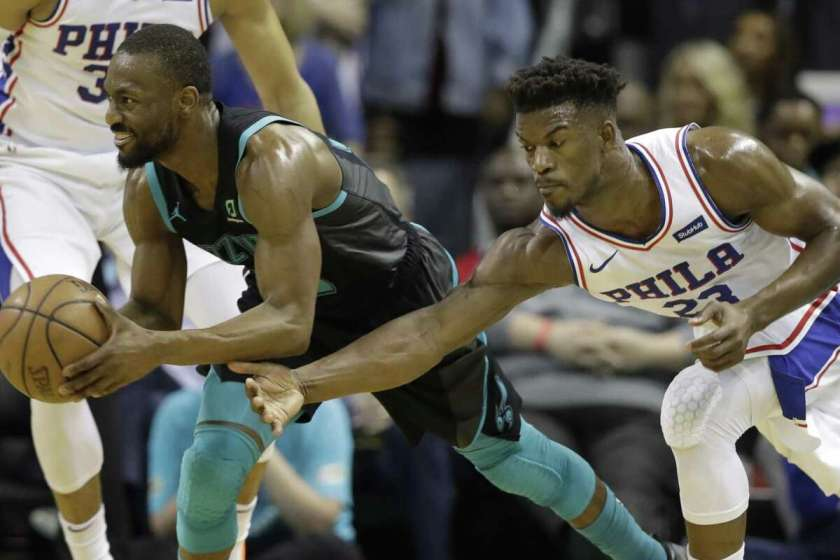 c121b477dc8a 3of7Philadelphia 76ers' Jimmy Butler (23) reaches in on Charlotte Hornets'  Kemba Walker (15) during the second half of an NBA basketball game in  Charlotte, ...