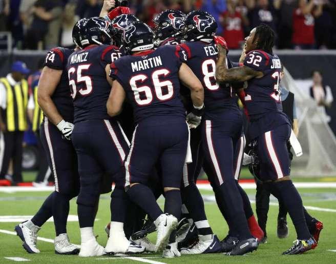 The Texans celebrate kicker Ka'imi Fairbairn's 28-yard overtime field goal to beat the Bills 22-19 in Saturday's AFC wild-card game at NRG Stadium.