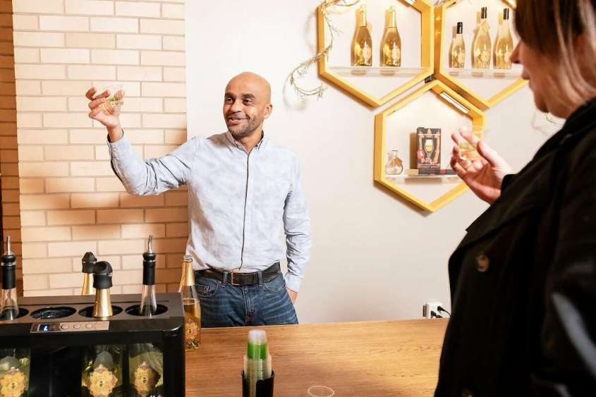 Ayele Solomon describes his honey wines to guests during a tasting at the Bee D'Vine tasting bar at the Ferry Building.
