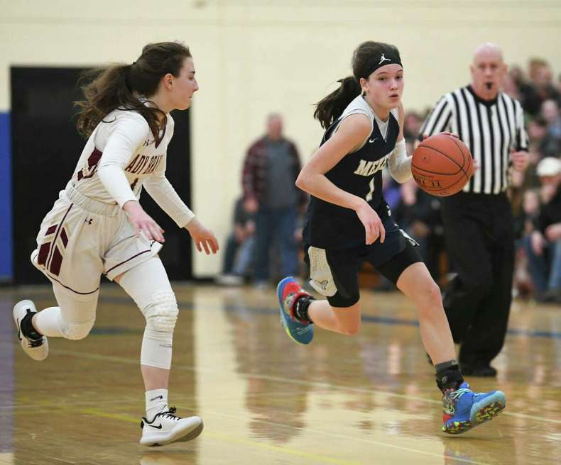 Mekeel Christian Academy's Avery Mills is guarded by Fonda's Kyla Smith in a game in 2020. Mills is getting lots of playing time at the end of important games for Winston-Salem Christian in North Carolina as a freshman. (Lori Van Buren/Times Union)