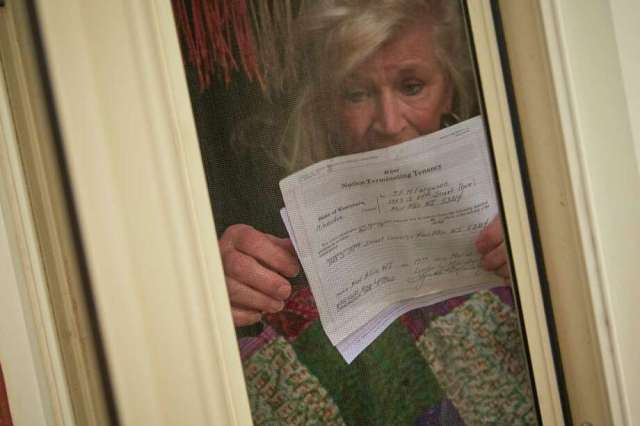 Jill Ferguson, 66 stands for a portrait with a eviction notice at her home last month in West Allis Wis. Photo: Photo For The Washington Post By Darren Hauck. / Darren Hauck
