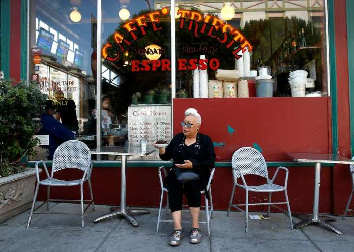 Paulette Baker, a longtime regular at Caffe Trieste, savored an Americano espresso in 2017. Photo: Paul Chinn / The Chronicle 2017