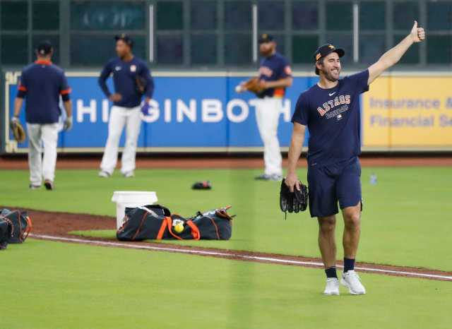 Houston Astros pitcher Justin Verlander gives thumbs up to George Springer shagging balls during the Astros summer camp at Minute Maid Park, Wednesday, July 15, 2020, in Houston.
