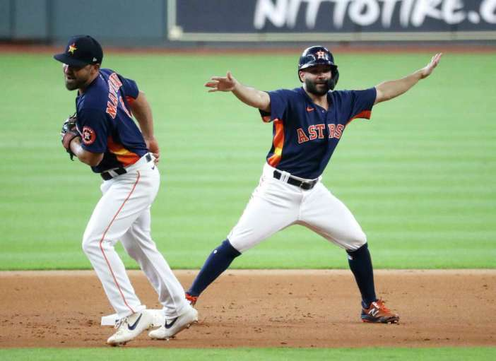 Houston Astros Jose Altuve tries to signal he is safe at second after getting tagged out by Jack Mayfield during an intrasquad game during the Astros summer camp at Minute Maid Park, Wednesday, July 22, 2020, in Houston.