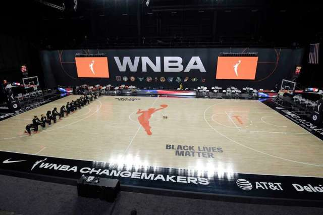 Members of the Connecticut Sun kneel during the playing of the national anthem before a WNBA basketball game against the Indiana Fever, Tuesday, Aug. 18, 2020, in Bradenton, Fla. The members of the Indiana Fever left the court before the song was played. (AP Photo/Phelan M. Ebenhack) Photo: Phelan M. Ebenhack / Associated Press / Copyright 2020 The Associated Press. All rights reserved.