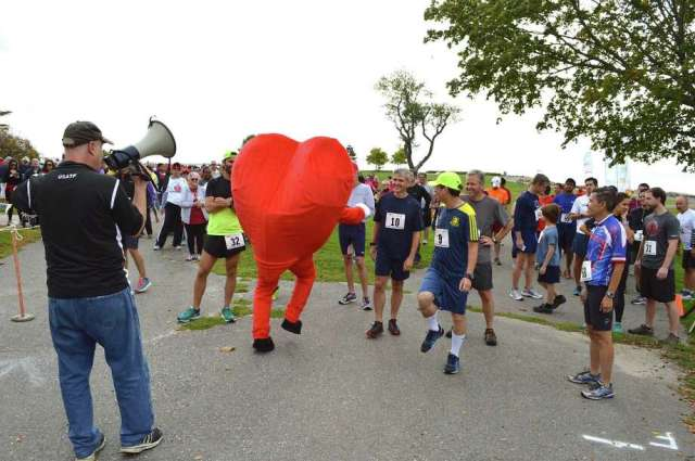 The American Heart Association mascot helps keep it light before the 5K at the 26th annual Fairfield County Heart Walk in 2016 in Westport. Photo: File Photo / Westport News Freelance