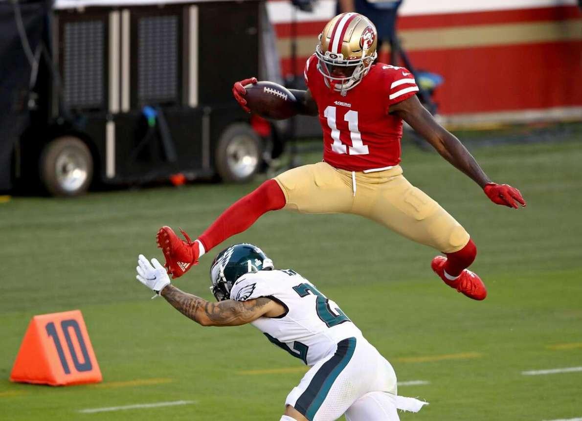 WATCH: 49ers receiver Brandon Aiyuk hurdles Eagles defender for crazy  touchdown