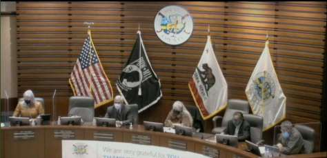 Members of the Solano County Board of Supervisors meet on Nov. 17, 2020. Prior to the meeting, a small group of protesters angry at mask requirements extended their arms in Nazi salutes and compared the board to the Third Reich.