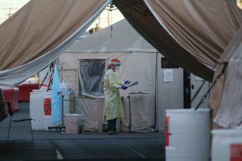 A worker is seen at a coronavirus testing site in San Francisco in November. The city has had no known cases of the South Africa variant, but elsewhere in the Bay Area two cases have been recorded.