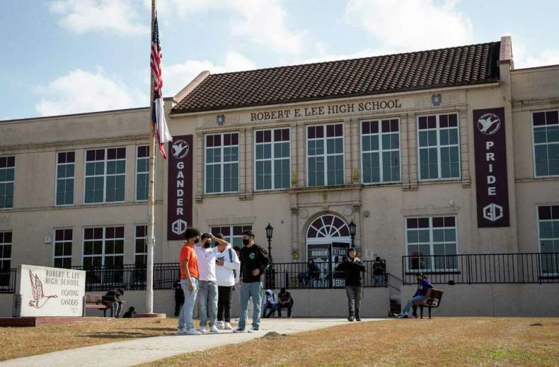 Students leave Friday, Feb. 26, 2021, at Robert E. Lee High School in Baytown.