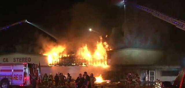 Firefighters battling a three-alarm fire early Thursday at a north Houston shopping center.