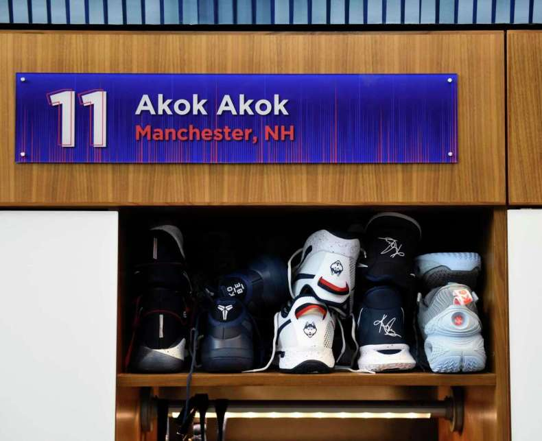 Many shoes in Akok Akok's locker in the men's basketball practice facility in the Werth Family UConn Basketball Champions Center on the UConn main campus in Storrs, Conn., photographed on Wednesday, June 9, 2021.