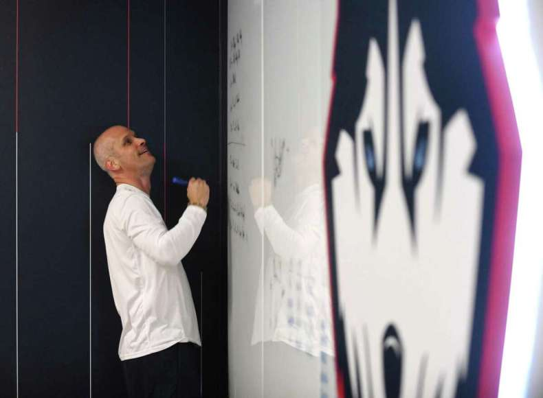 UConn men's basketball coach Dan Hurley writes on the whiteboard during a meeting with assistant coaches before practice at the Werth Family UConn Basketball Champions Center on the UConn main campus in Storrs, Conn. Wednesday, June 9, 2021.