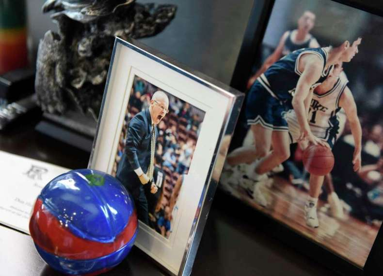 UConn men's basketball coach Dan Hurley shows items on his office desk at the Werth Family UConn Basketball Champions Center on the UConn main campus in Storrs, Conn. Wednesday, June 9, 2021.