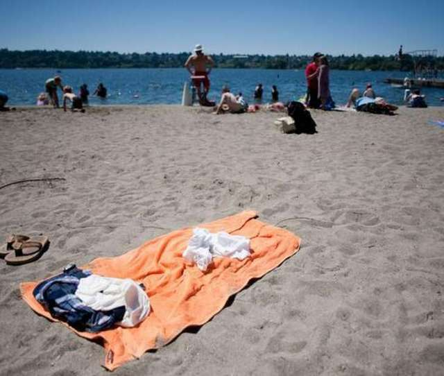 Family And Friends Come Out To Enjoy The Sun At Green Lake Pictured In A
