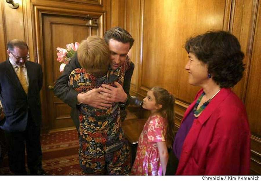 Same-sex marriage story continues.an Francisco Mayor Gavin Newsom congratulates Dale Schroedel (back to camera) and Lisa Honig (R) of San Francisco in his office just before he gave a press conference in reaction to the California Supreme Court decision. Their daughter Isabel Honig Schroedel is in middle. They were among the last couples married before the ban took effect. Word spreads at San Francisco City Hall that the California State Supreme Court ordered an immediate halt to same sex marriage in the City.  Chronicle photo by Kim Komenich in San Francisco Photo: Kim Komenich
