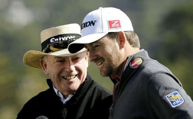 Kenny and Graeme McDowell, father and son share a laugh after they finished up on the 18th green, during a practice round on Tuesday Feb. 4, 2014, before the start of the Pebble Beach National Pro-Am golf tournament in Pebble Beach, Calif.